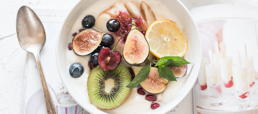 Nice looking breakfast bowl with oranges, kiwis and other fruits.