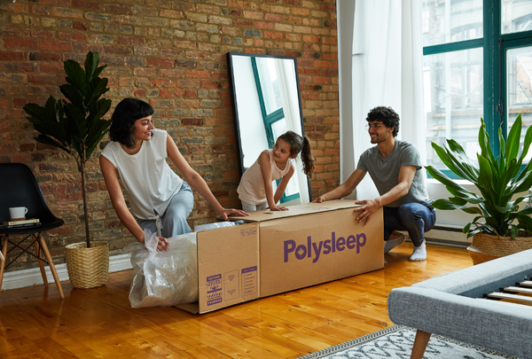 Woman unpacking her Polysleep mattress from its box