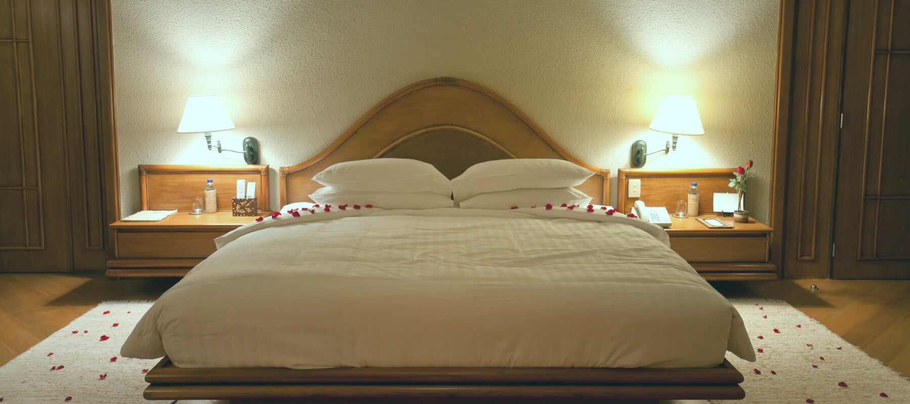 One King bed in a low-light bedroom