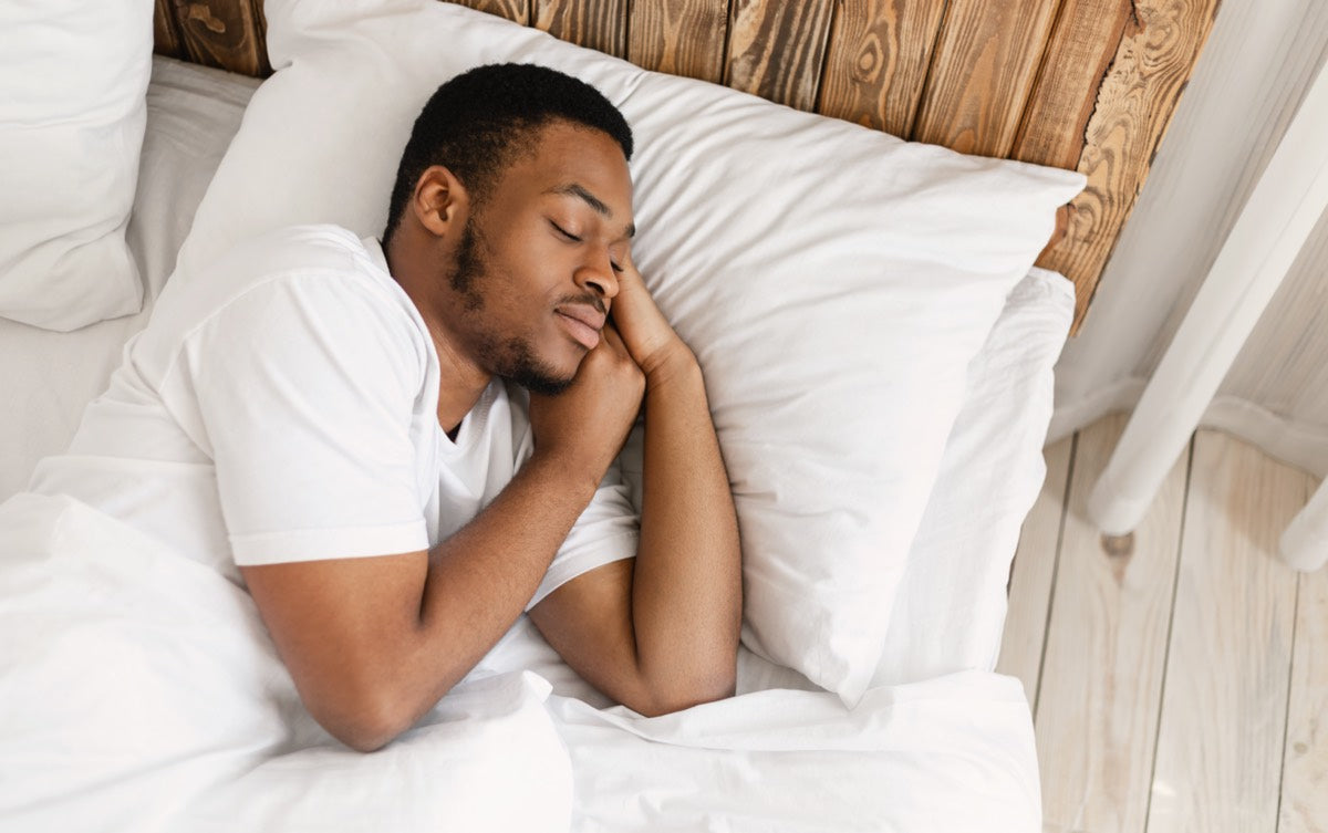 Man sleeping peacefully in comfortable bed