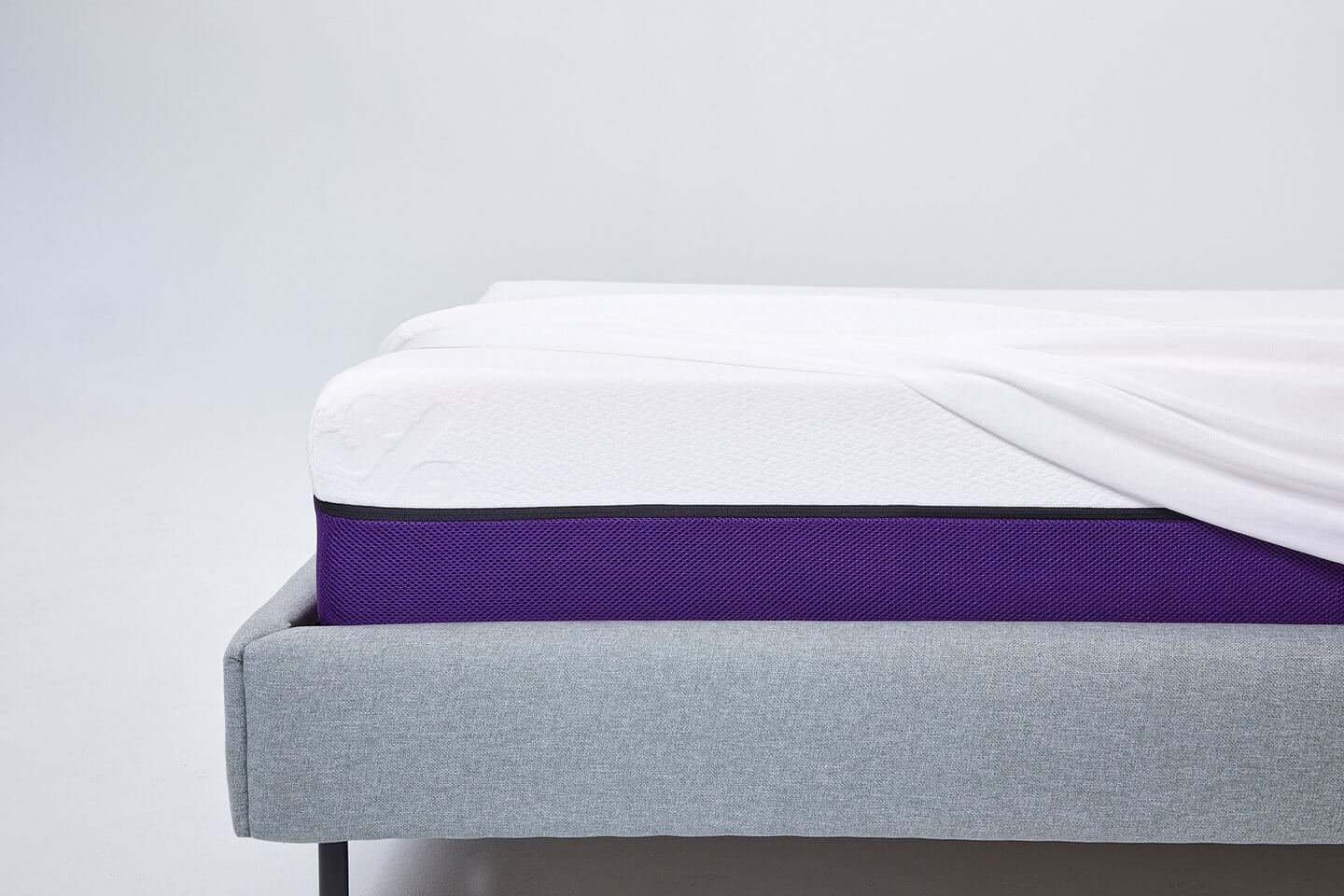 The Polysleep waterproof mattress protector unfolded from the corner of the Polysleep bed