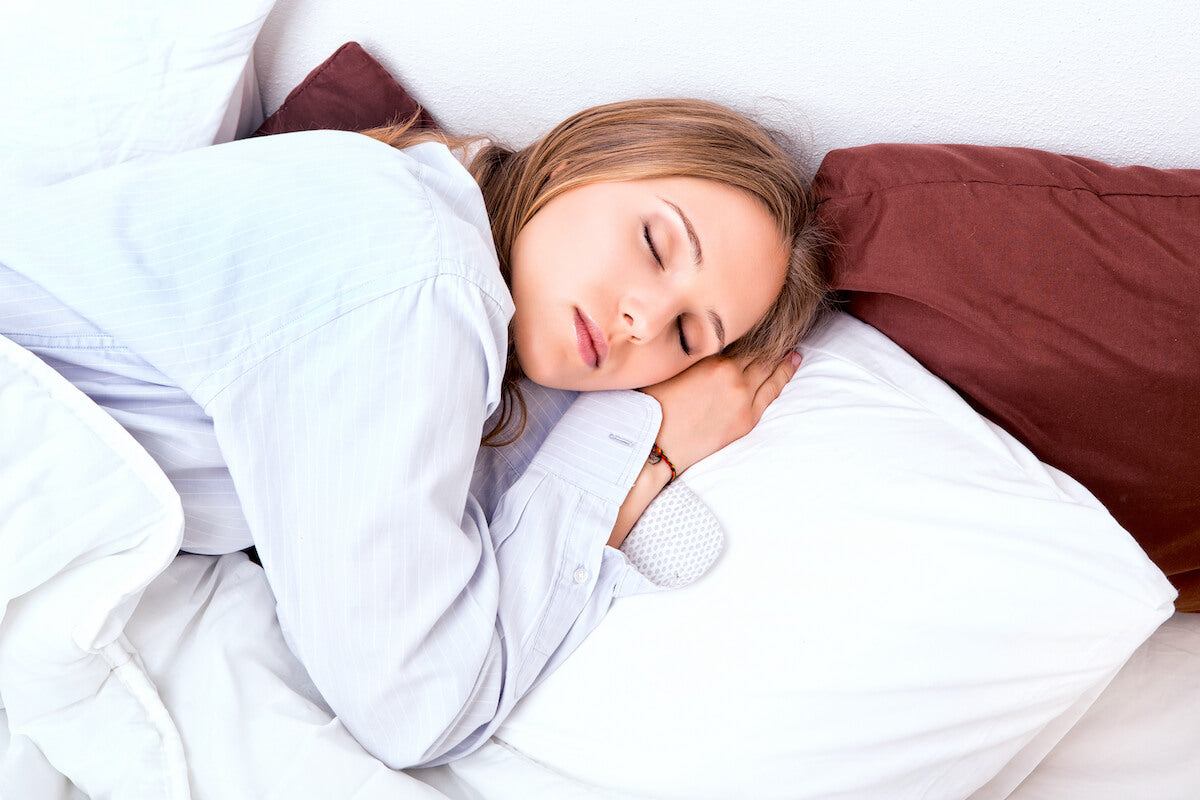 Woman sleeping with her head lying on a firm pillow