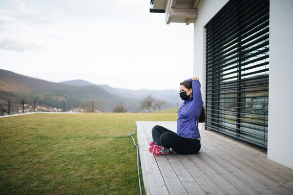 Woman stretching outside at home, Corona virus and quarantine concept