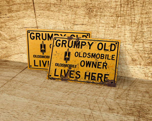 Grumpy old Oldsmobile owner lives here metal sign