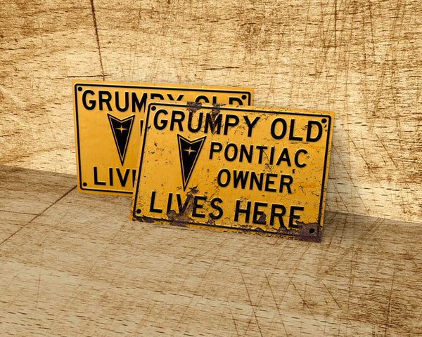 Grumpy old Pontiac owner lives here metal sign