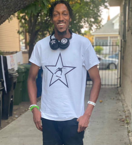 Mo Duncan smiling with headphones