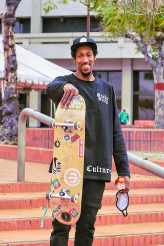 Mo Duncan smiling with skateboard