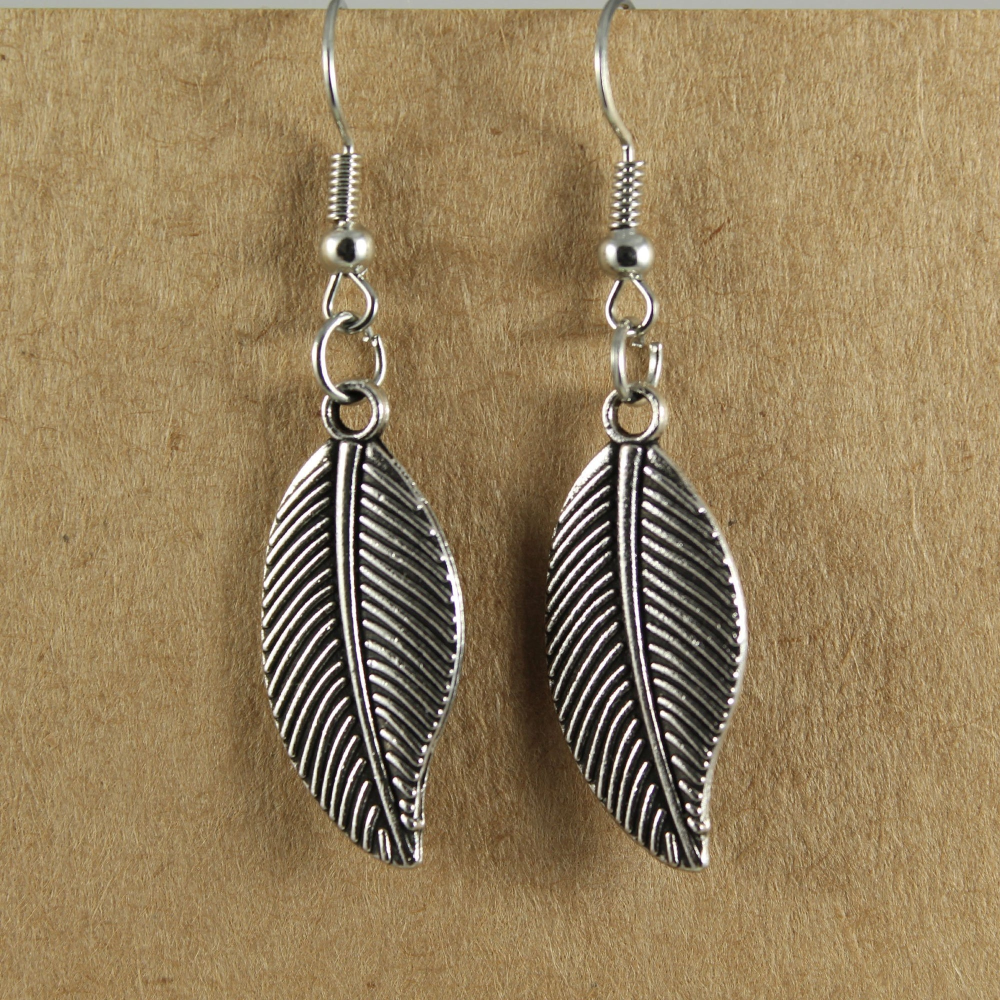 Metallic feather earrings | Earrings - The Naughty Shrew