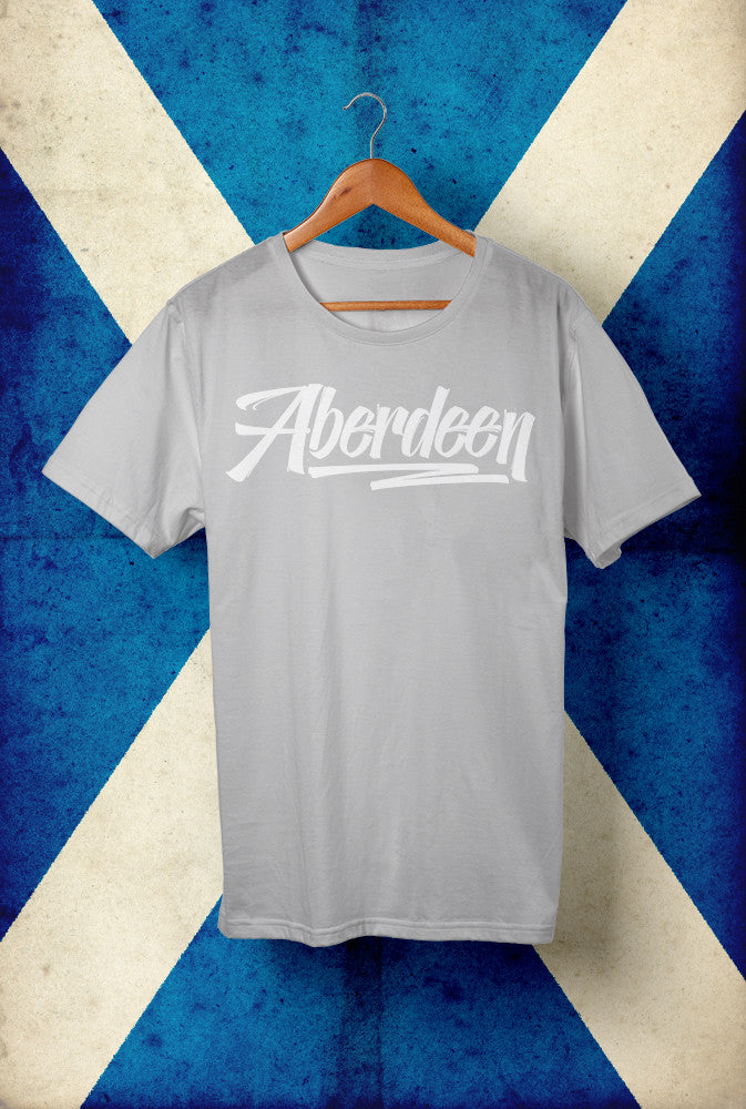Aberdeen Script with White Ink <p> Unisex Gildan T Shirt In Red, Grey, Blue and Black Custom T Shirt by Lets Get Shirty Dot Com