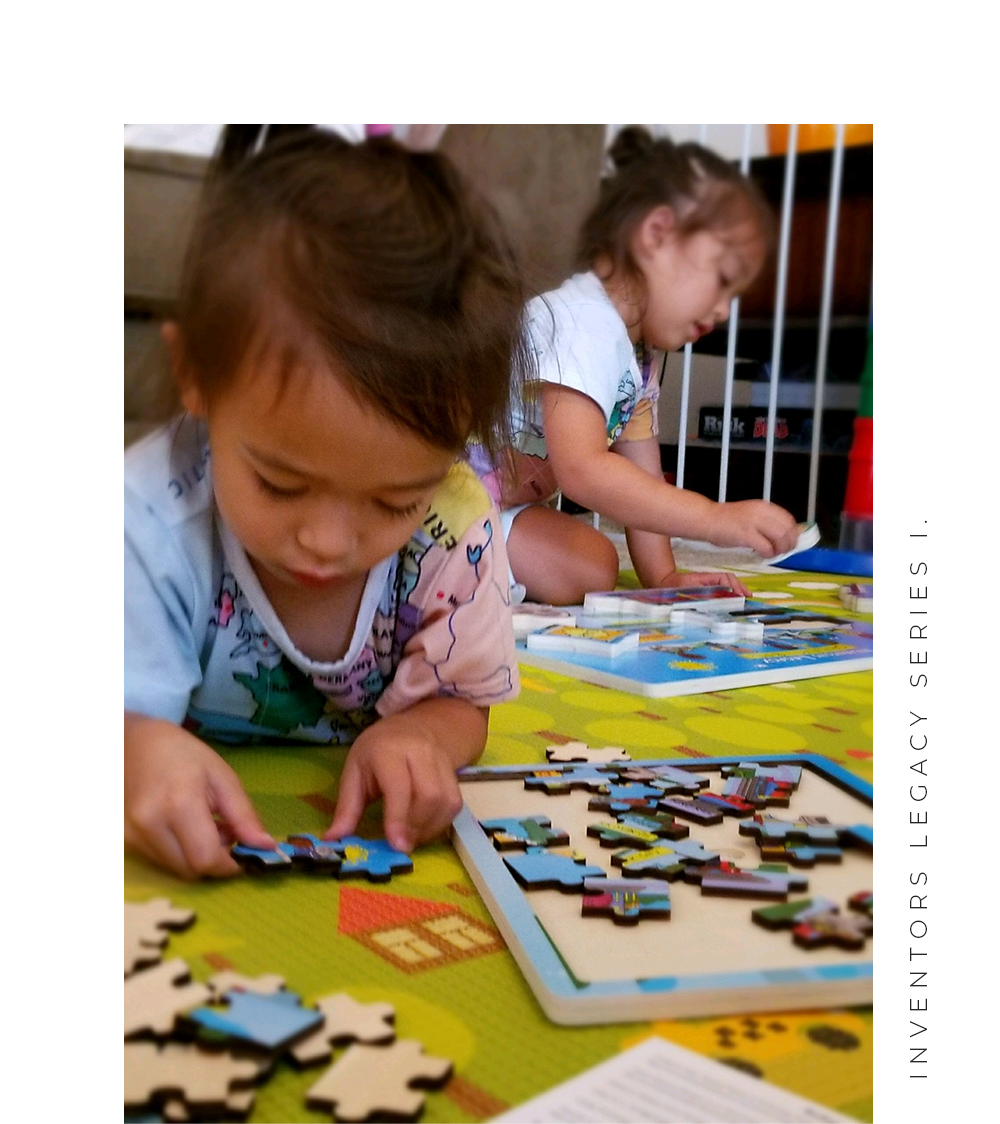 Child playing with Inventors Legacy Series 1 48 piece wooden jigsaw puzzle.