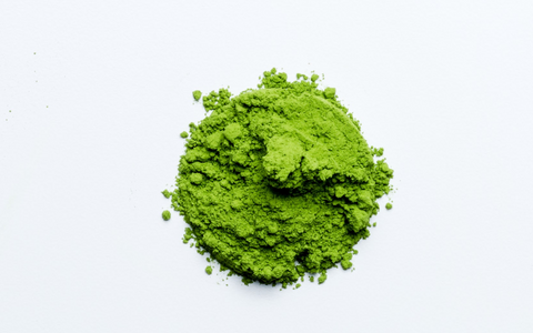 ceremonial matcha is the most vibrant green authentic quality, pictured against a white background, in a round pile