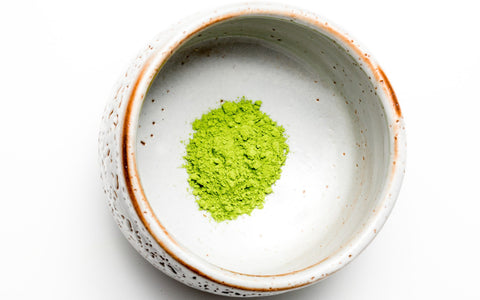 culinary grade matcha in a white matcha bowl chawan with golden edges, on a white background