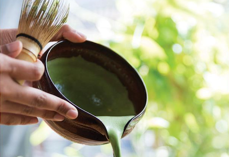 Ceremonial matcha green tea preparation in Japan. Thick tea with a chawan and chasen
