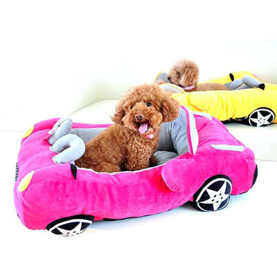Two Toy Poodles Inside a Sports Convertible Race Car Shaped Dog Bed in Hot Pink & Sunny Yellow Pawsome Market.