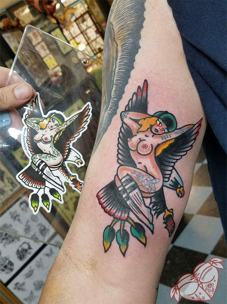 American Traditional tattoo flash sexy sailor jerry west coast eagle pinup sticker next to matching tattoo.
