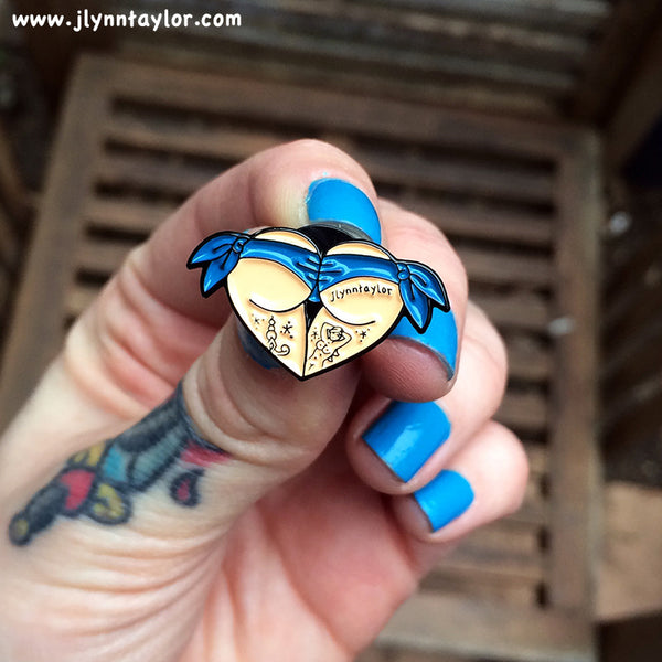 American traditional tattoo flash blue scrunch butt bikini butt heart enamel pin.