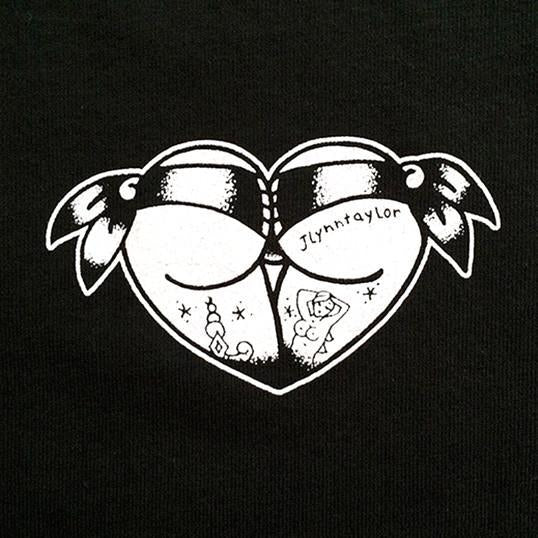 Tattoo style butt heart logo on black shirt.