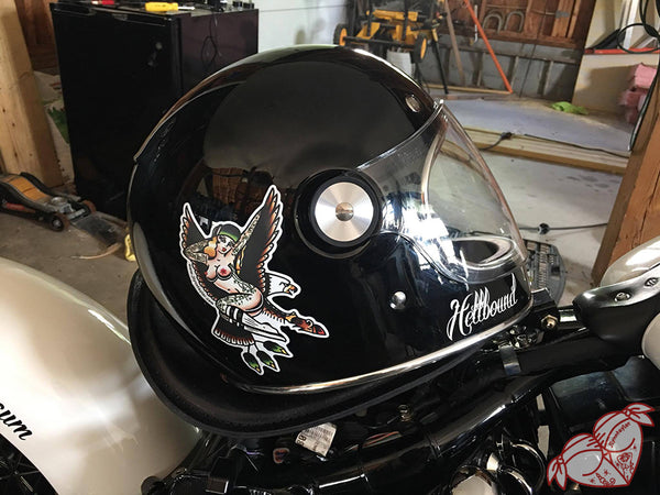 American Traditional tattoo flash sexy sailor jerry west coast eagle pinup sticker on motorcycle helmet.