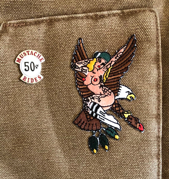 American traditional tattoo flash Sailor Jerry eagle pinup embroidered patch on canvas vest.