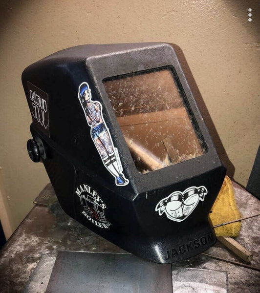American traditional tattoo flash stickers on welding hood.