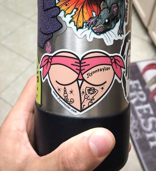 American Traditional tattoo flash pink scrunch bikini butt heart sticker on water bottle.