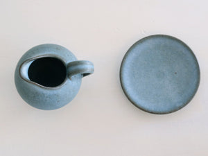 Milkpitcher and saucer