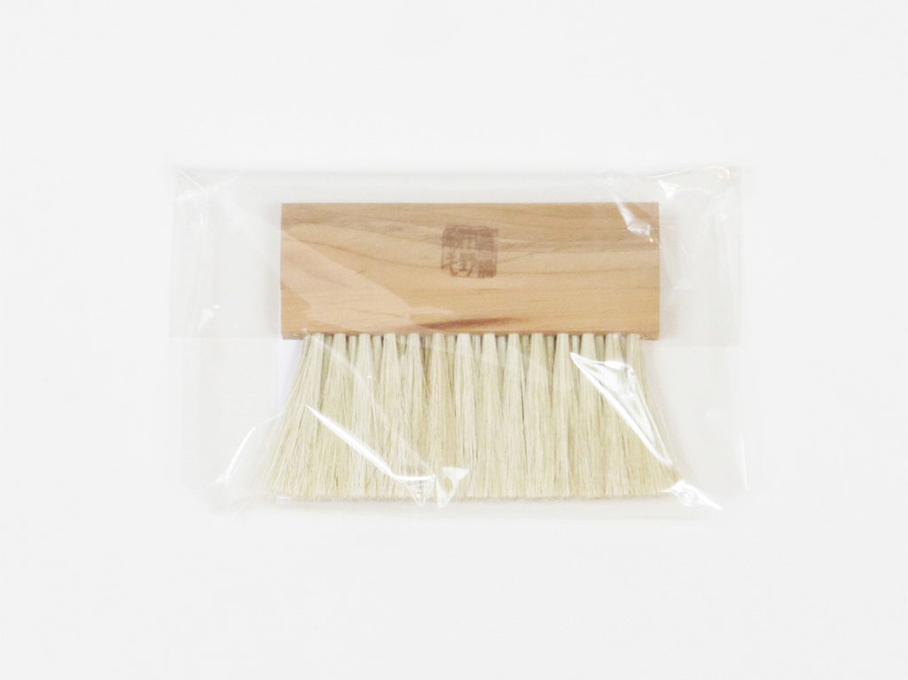 Uno Hake Travel size Clothes Brush