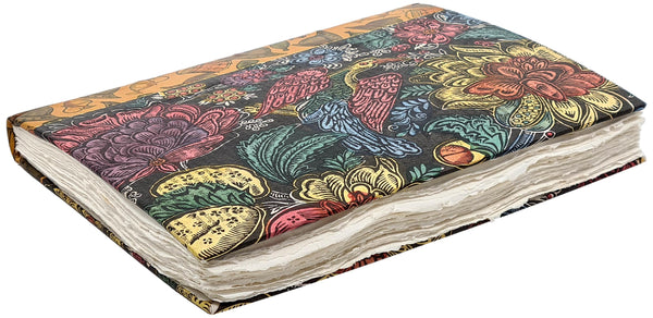 deckled edges of vintage handmade paper on a properly made book