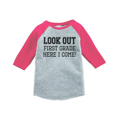 7 ate 9 Apparel Girls Look Out 1st Grade Pink Baseball Tee