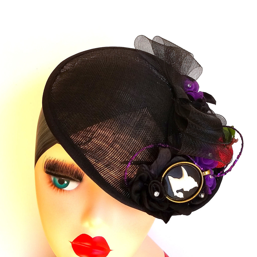 A disney evil queen inspired fascinator for cosplay, dapper day, pinup, vintage, disneybound, halloween costume fascinator.