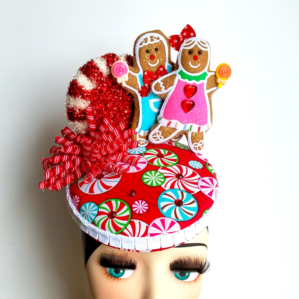 Gingerbread cookie fascinator pillbox hat with peppermint candy. For christmas or candyland theme. Colors are red and white with stripes.