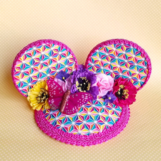 FascinEars by Hat and Mouse. Spaceship Earth and Epcot Flower and Garden Festival inspired fascinator hat with mouse ears and flower crown for dapper day and disneybound.