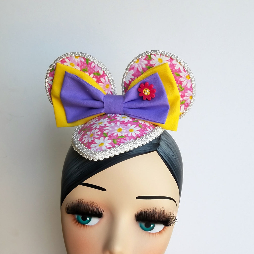 FascinEars by Hat and Mouse. Daisy Duck Flower and Garden Festival inspired fascinator hat with mouse ears for dapper day and disneybound.