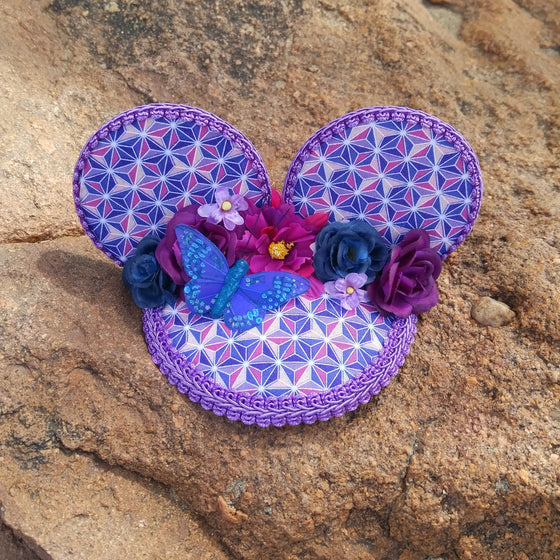 FascinEars by Hat and Mouse. Spaceship Earth and Epcot Flower and Garden Festival Violet Lemonade inspired fascinator hat with mouse ears and flower crown for dapper day and disneybound.