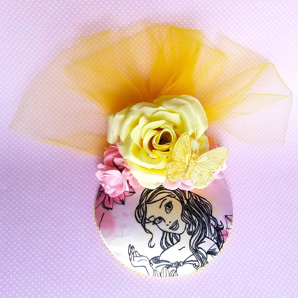 Pastel Belle Beauty and the Beast fascinator hat with roses in pink and yellow for disneybound or disney dapper day.