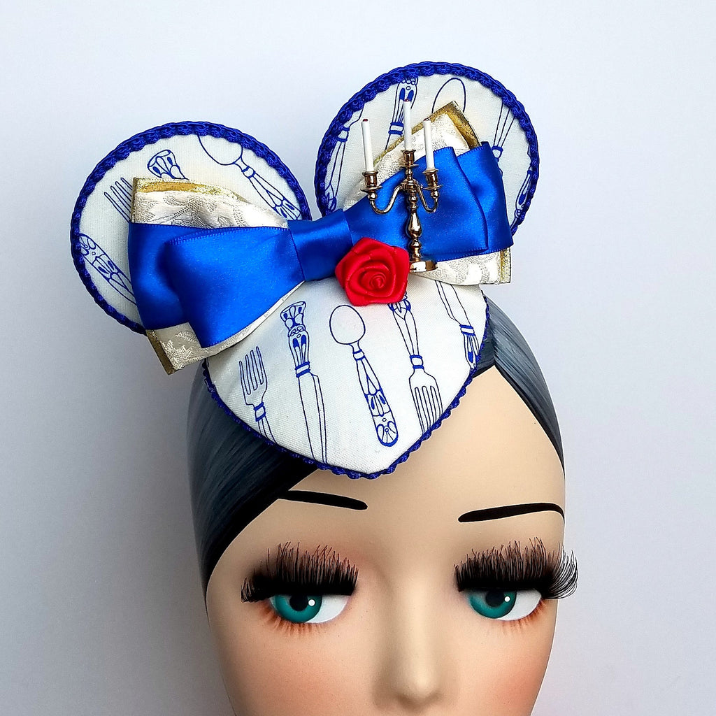 Be our guest mouse ear fascinator in blue and gold featuring lumiere beauty and the beast for disneybound or disney dapper day.