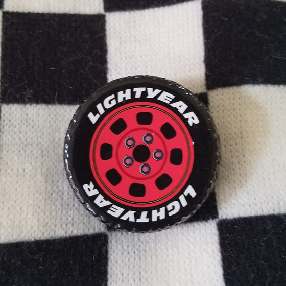 Lightyear tire brooch inspired by cars lightning mcqueen and carsland. For disney dapper day or disneybound.