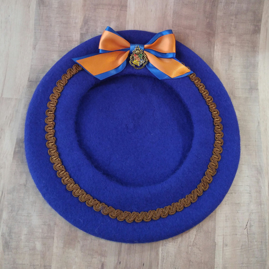 Hogwarts school winter beret hat in blue and bronze ravenclaw colors.