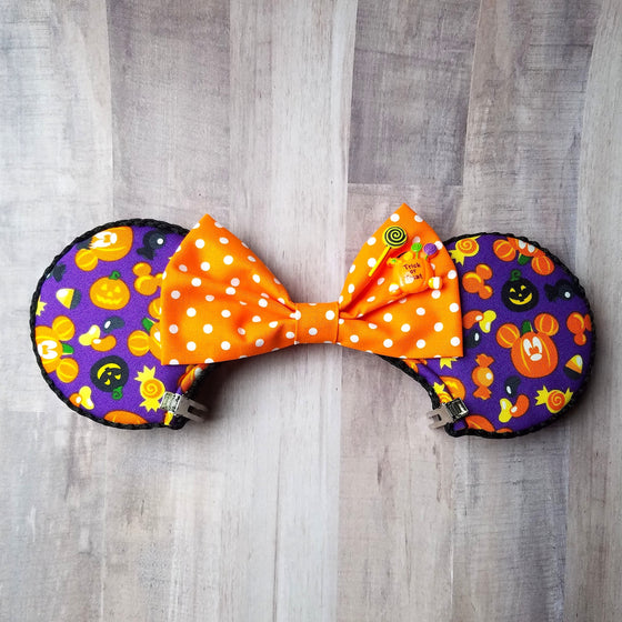 Mouse ears with mickey pumpkins for disney halloween.