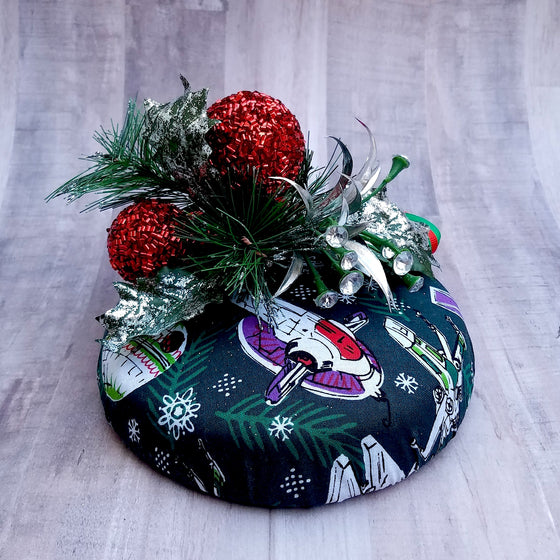 Star wars ornament christmas pillbox hat featuring millenium falcon, death star and tie fighters.
