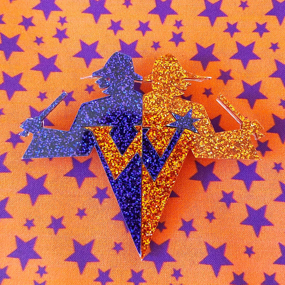 Weasley's wizard wheezes from harry potter purple and orange logo glitter brooch pin.