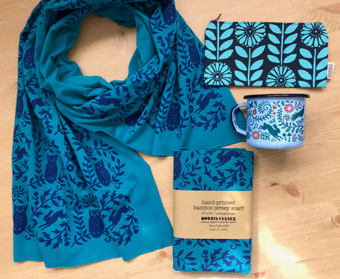 Blue hand-printed scarf, enamel coffee mug, hand-printed zipper pouch made in Maine by Morris & Essex