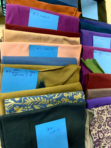 stacks of bamboo fabric with post-it notes