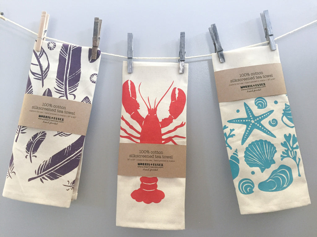 hand printed purple feathers cotton tea towel with hanging loop