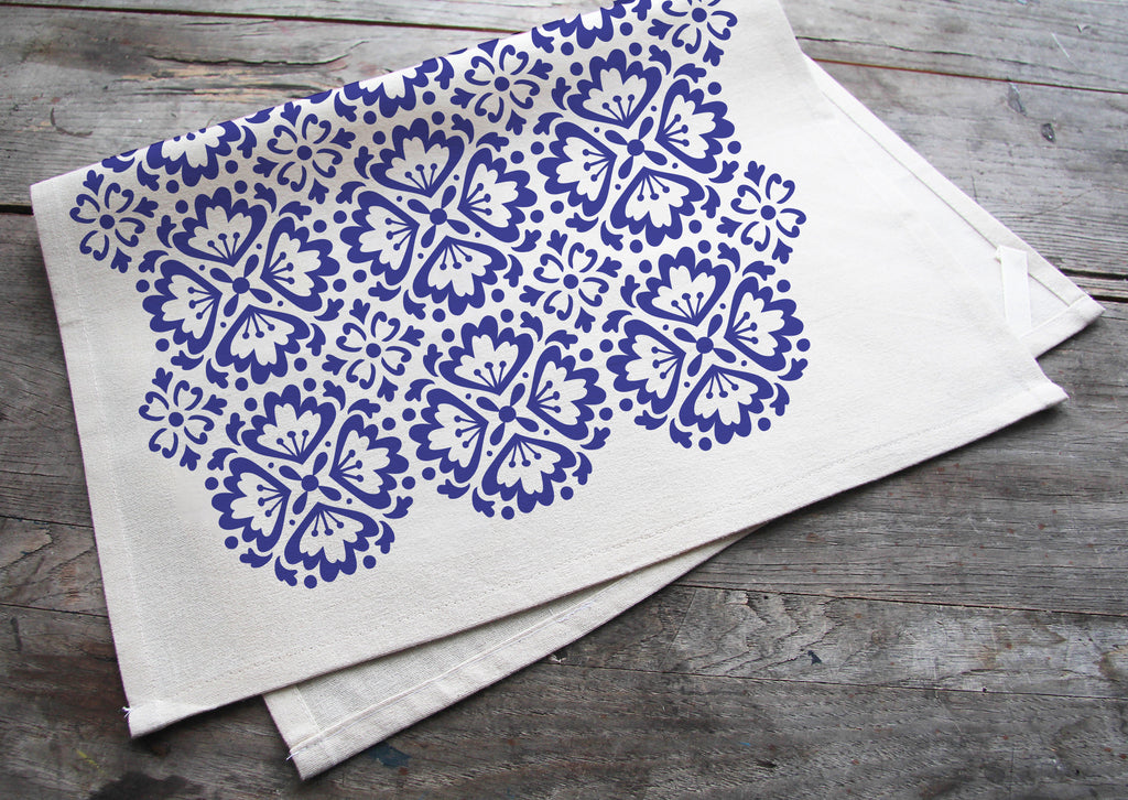 hand printed blue spanish tile cotton tea towel with hanging loop