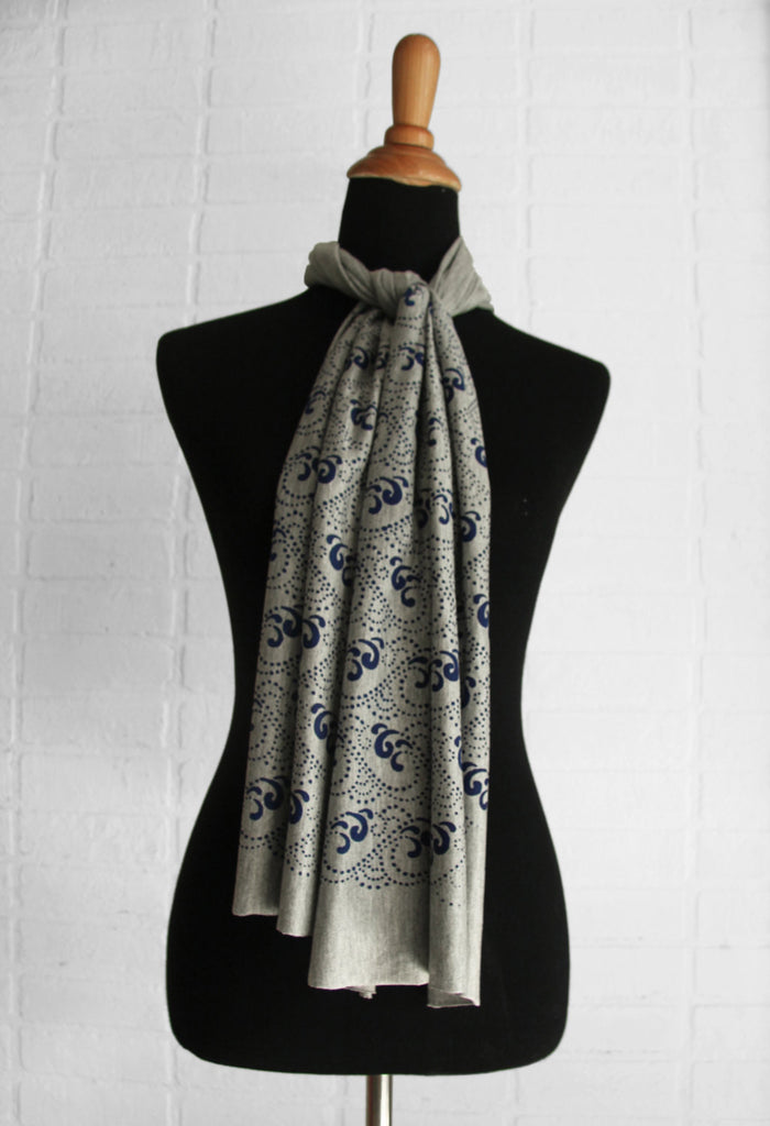 hand-printed scarf on black mannequin, gray scarf with blue waves pattern, handmade in Maine by Morris and Essex