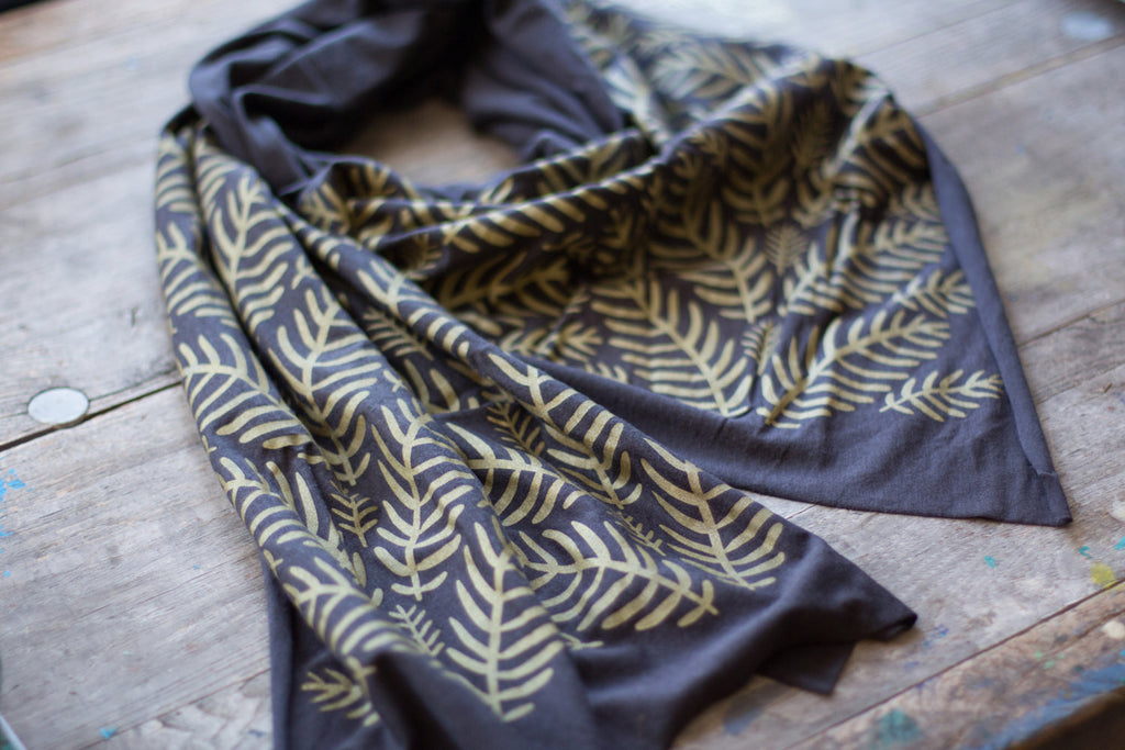 hand-printed neutral grey scarf with tropical leaves pattern, handmade in Maine by Morris and Essex