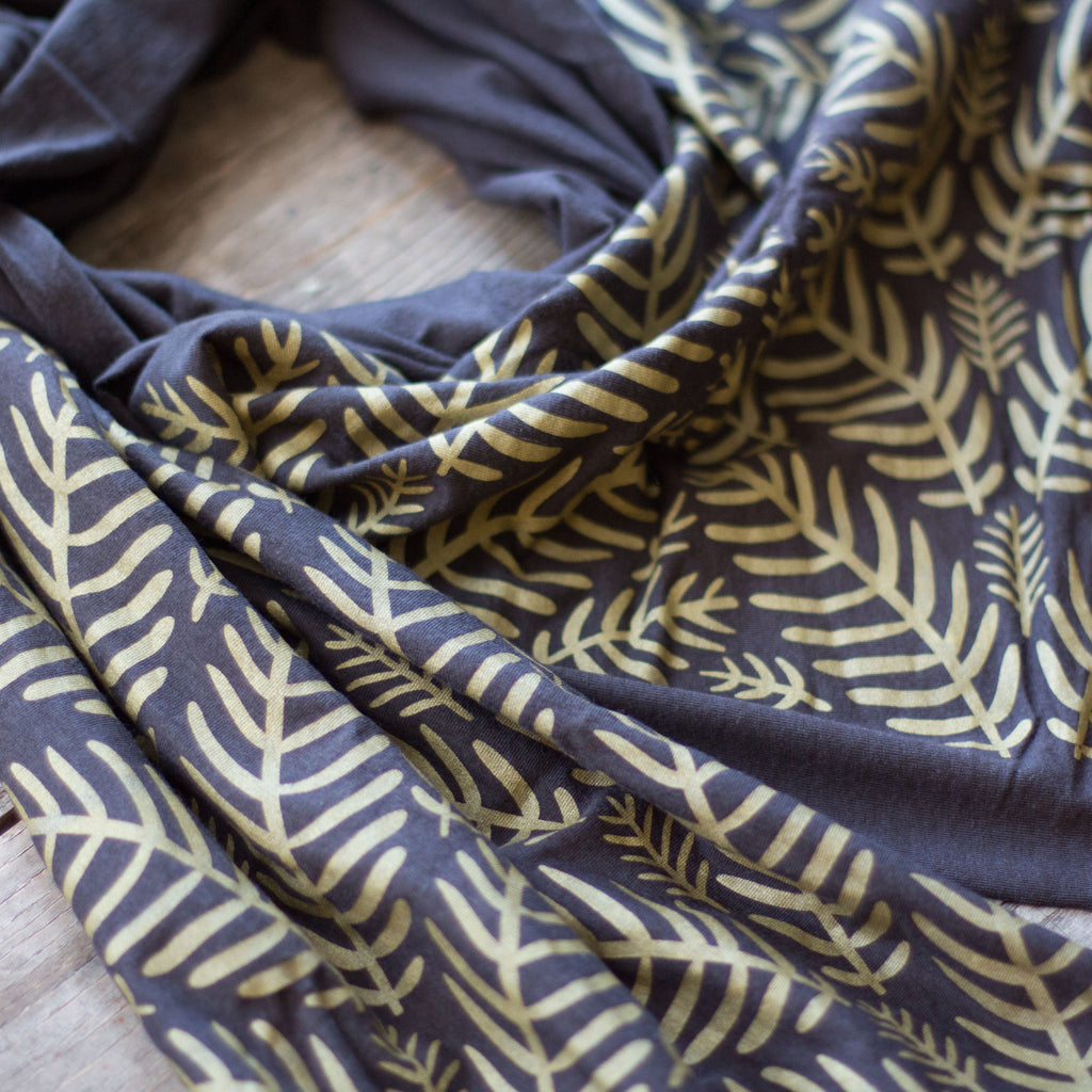 Charcoal grey bamboo scarf with hand-printed gold Tropical Leaves pattern
