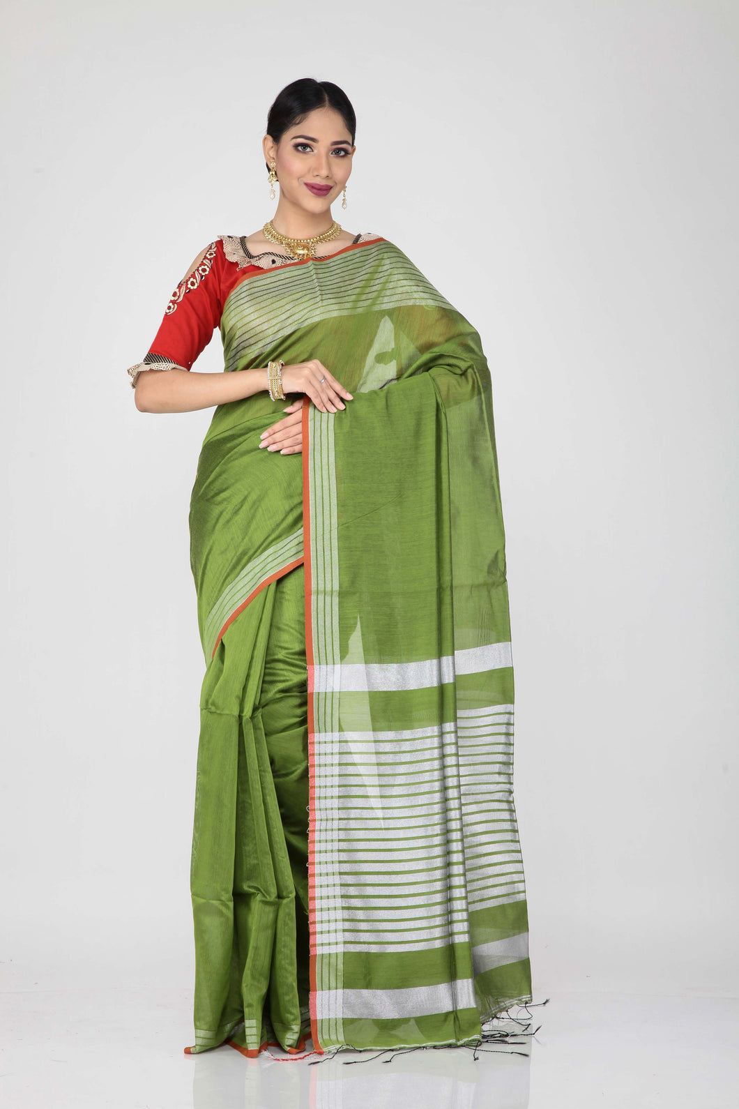 The lady is wearing a green handloom saree