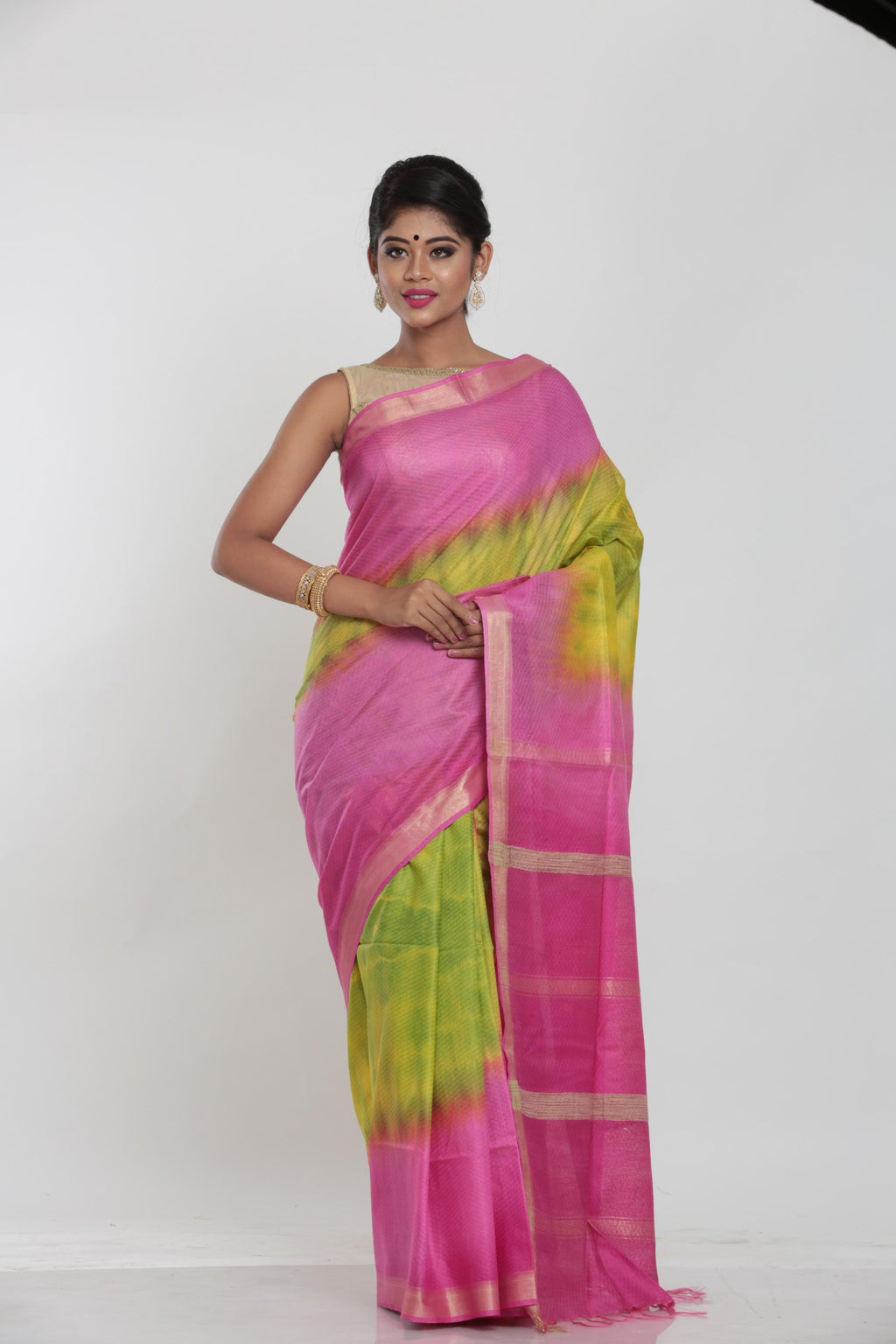 GREEN COLOUR MUGA HANDLOOM SAREE WITH CONTRASTING TIE AND DIE EFFECT